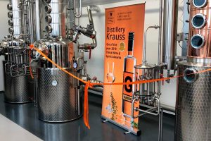 Distillery Krauss boiler connected with orange ribbon on the day of the official opening.