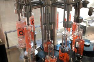 Photo from the bottling of the Distillery Krauss. You can see how the bottles are filled in the filling system.
