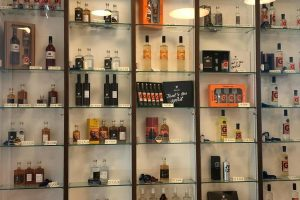 Photo from the sales room of the Distillery Krauss. You can see a shelf with many different products from the Distillery Krauss
