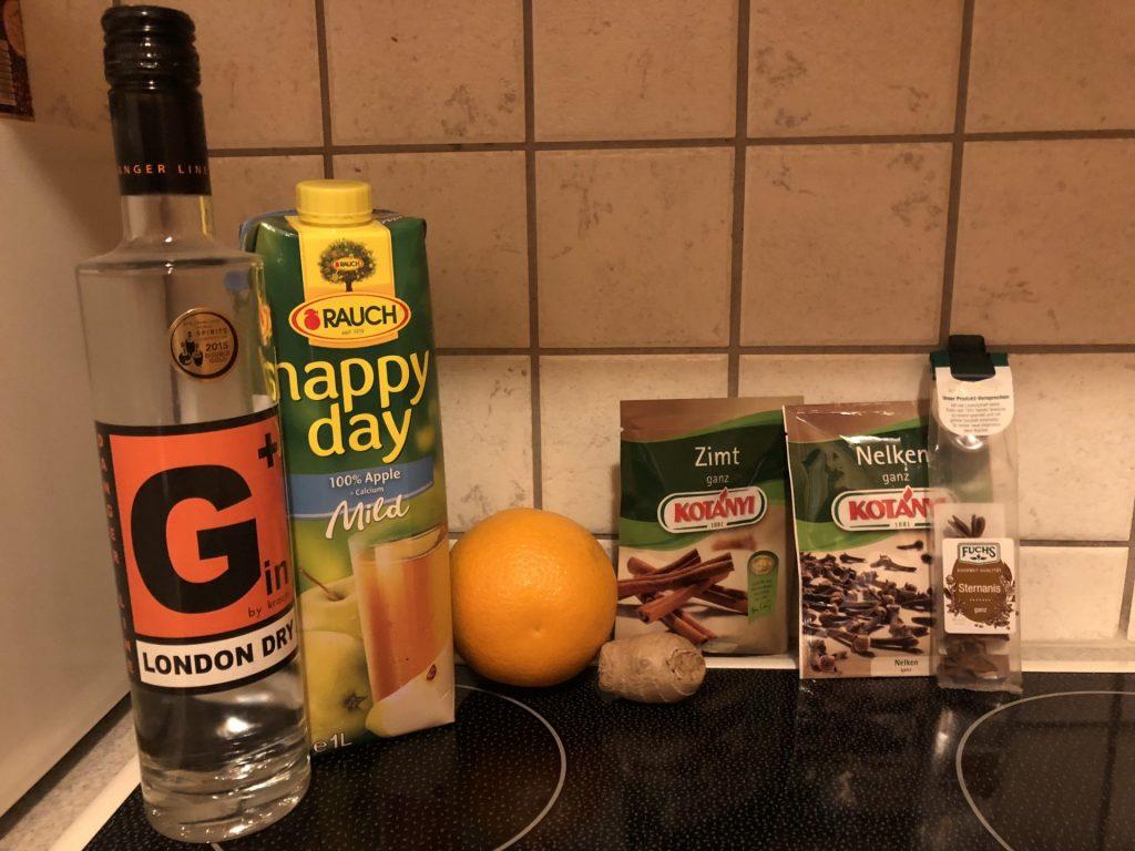 Ingredients for mulled gin: G + Krauss gin, mild apple juice, orange, cinnamon, ginger, cloves, star anise